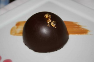 Chocolate bombe dessert with real gold leaf